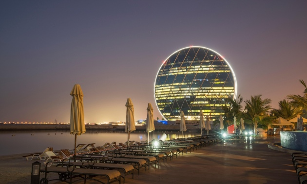 AlDar Headquarters in Abu Dhabi is world's first circular skyscraper. UAE-based MZ Architects have built a revolutionary 'stacked dinner plate' prototype – at a cost of around £1bn. Courtesy of The Guardian, photo by Alamy
