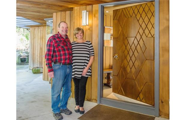 Image: Jan Pidhirny and Jim Ferguson with the now famous front door of their Ron Thom designed home in West Vancouver. Courtesy of Vancouver Sun, photo by Ric Ernst